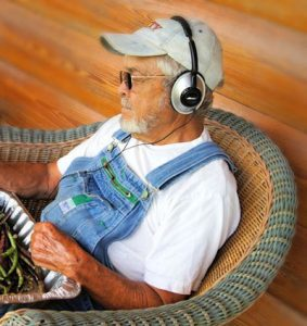 Senior man with headphones